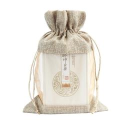 Bolsa de regalo con lazo de organza de arpillera